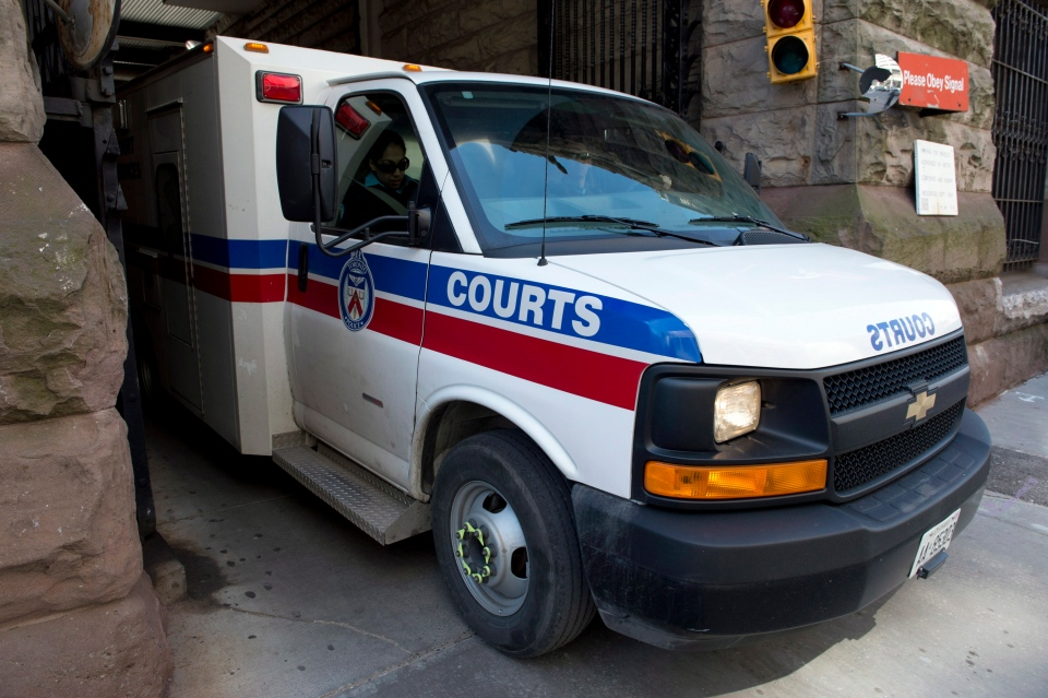 A transport van carrying Raed Jaser leaves court in Toronto on Tuesday, April 23, 2013.  (Frank Gunn / THE CANADIAN PRESS)