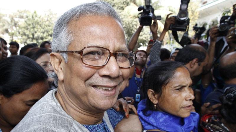 Bangladeshi Nobel laureate Muhammad Yunus smiles as he arrives at the High Court in Dhaka, Bangladesh, Thursday, March 3, 2011. (AP Photo/Zia Islam)