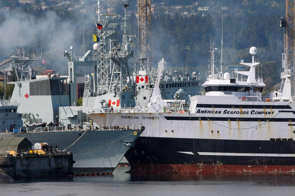 The American Seafood Company vessel American Dynasty (right) collides with the docked HMCS Winnipeg which has just undergone a massive refit and upgrade in Esquimalt, B.C., Tuesday April 23, 2013. (Chad Hipolito / THE CANADIAN PRESS)