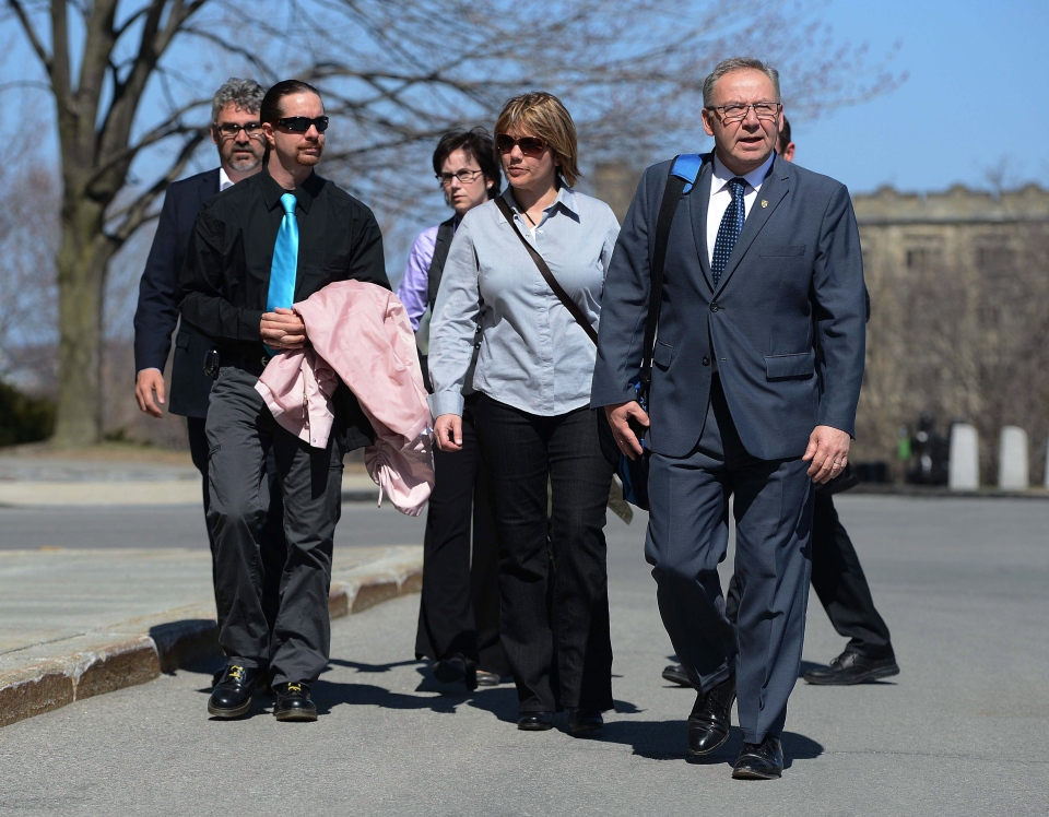 Nova Scotia Premier Darrell Dexter, right, arrives on Parliament Hill with Leah Parsons, middle right, mother of Rehtaeh Parsons and her partner Jason Barnes as well as her father Glen Canning, back left, and wife Krista, back right, in Ottawa on Tuesday, April 23, 2013. (Sean Kilpatrick / THE CANADIAN PRESS)