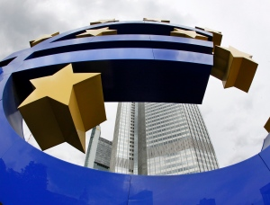 The Euro sculpture stands in front of the European Central Bank ECB in Frankfurt, central Germany. (AP Photo/Michael Probst)
