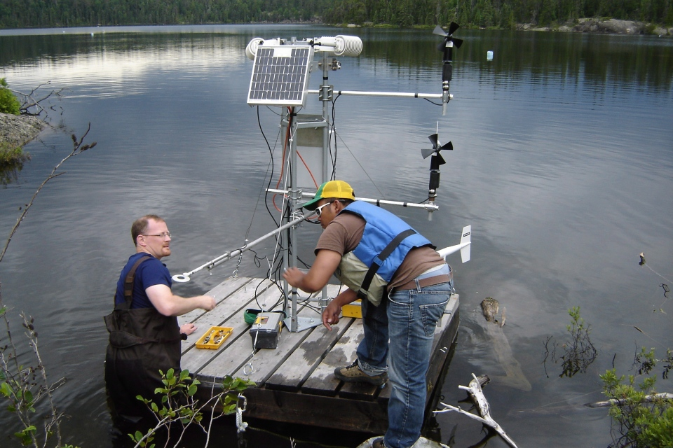 Scientists set-up a raft with one of a series of micro-meterological stations on a lake, in this undated photo. (Experimental Lakes Area)
