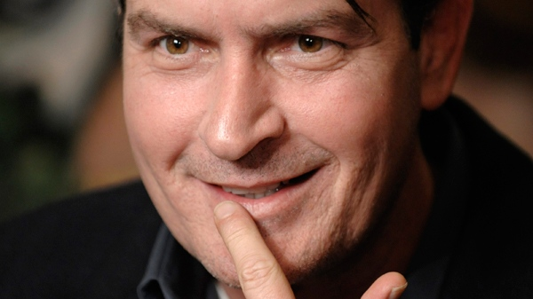 Charlie Sheen is interviewed at an event to celebrate Planet Hollywood's purchase of Italian restaurant chain Buca di Beppo, at Universal CityWalk in Los Angeles, Jan. 28, 2009. (AP / Chris Pizzello)