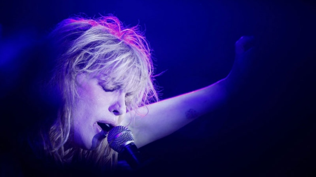 U.S. musician Courtney Love performs during a party at the Printemps general store in Paris, Tuesday, Oct. 5, 2010. (AP Photo/Laurent Cipriani)