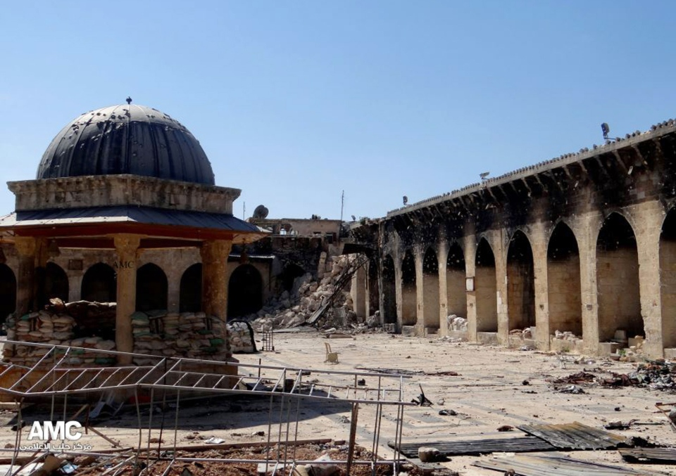 This image provided by Aleppo Media Center AMC  shows the damaged famed 12th century Umayyad mosque without the minaret, background right corner, in the northern city of Aleppo, Syria on April 24, 2013. (AP Photo/Aleppo Media Center)