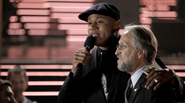 Host L.L. Cool J, left, speaks with the President of the Recording Academy Neil Portnow at the Grammy Nominations Concert on Wednesday, Dec. 1, 2010, in Los Angeles. (AP Photo/Matt Sayles)