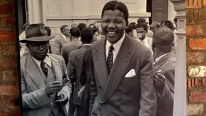 Nelson Mandela, right, and Moses Kotane, left, are seen leaving the court after the State withdrew the indictment during the Treason Trial, hanging in his room at the Liliesleaf Farm in Rivonia, north of Johannesburg, South Africa on Oct. 13, 1958. (AP / Themba Hadebe)
