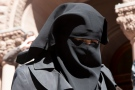 An unidentified woman wears a niqab outside an Ontario court house in Toronto on Tuesday, April 23, 2013. (The Canadian Press/Chris Young)