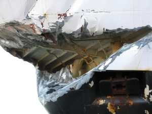 Damage is evident after a U.S. fishing boat collided into Canadian navy ship HMCS Winnipeg in Esquimalt harbour, near Victoria on Tuesday, April 23, 2013. <br><br>Damage to the bow of the fishing vessel American Dynasty is seen after a collision with the HMCS Winnipeg in Esquimalt, B.C. on Tuesday, April 23, 2013. (Transportation Safety Board of Canada)