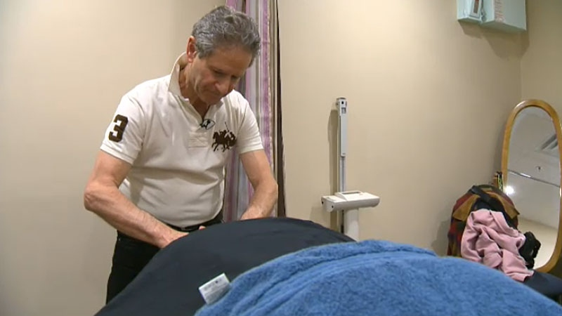 Hundreds of Alberta massage therapists - including Mikhail Moshinsky, may soon be out of work due to new insurance claim rules that don't recognize massage training done outside of Canada.