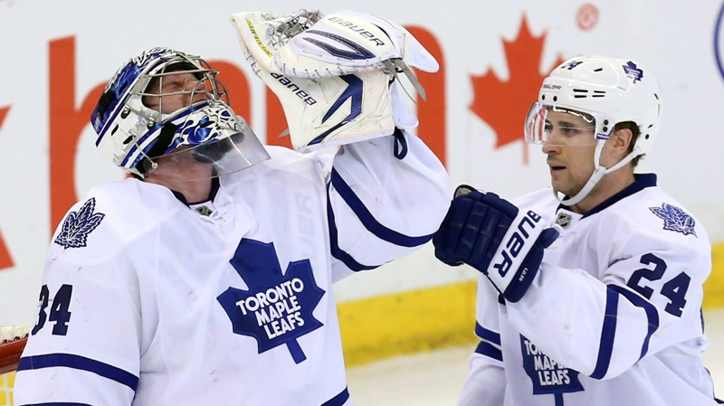 Maple Leafs' John-Michael Liles (24) celebrates with goaltender James Reimer (34) after the Leafs defeated the Ottawa Senators 4-1 in Ottawa, on Saturday April 20, 2013. (Fred Chartrand / THE CANADIAN PRESS)