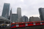 A train passes by London's financial area Canary Wharf in London, Wednesday, March 27, 2013. (AP Photo/Kirsty Wigglesworth)