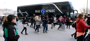 Young girls run towards pop singer Justin Bieber's tour bus as it parks outside Grand Hotel where Bieber were staying during his concerts in Stockholm, Sweden, Tuesday April 23, 2013. (Scanpix Sweden, Leo Sellen)