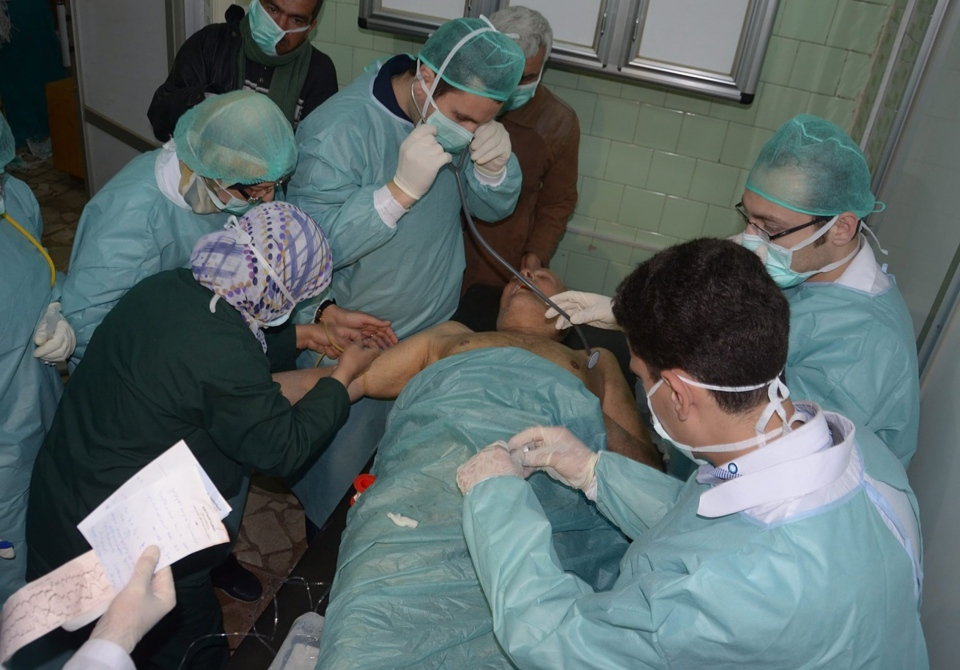 A Syrian victim who suffered an alleged chemical attack at Khan al-Assal village according to SANA, receives treatment by doctors, at a hospital in Aleppo, Syria, Tuesday March 19, 2013.  (SANA)