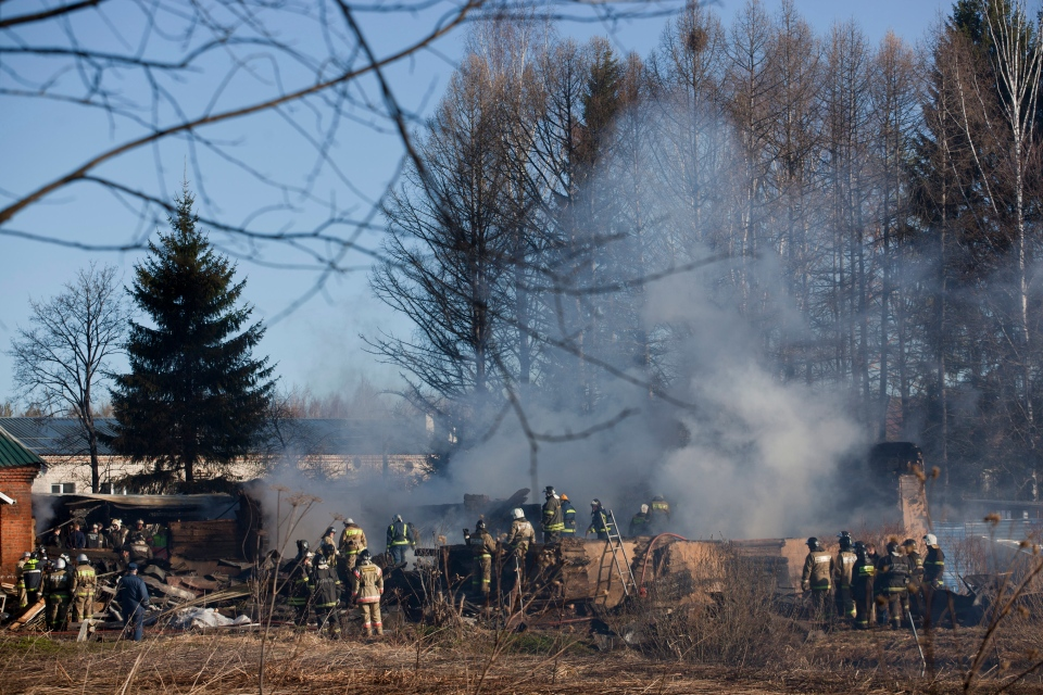 Ministry for Emergency Situations workers and firefighters work at a site of a fire of a psychiatric hospital Friday morning, April 26, 2013. (AP/ Pavel Sergeyev)