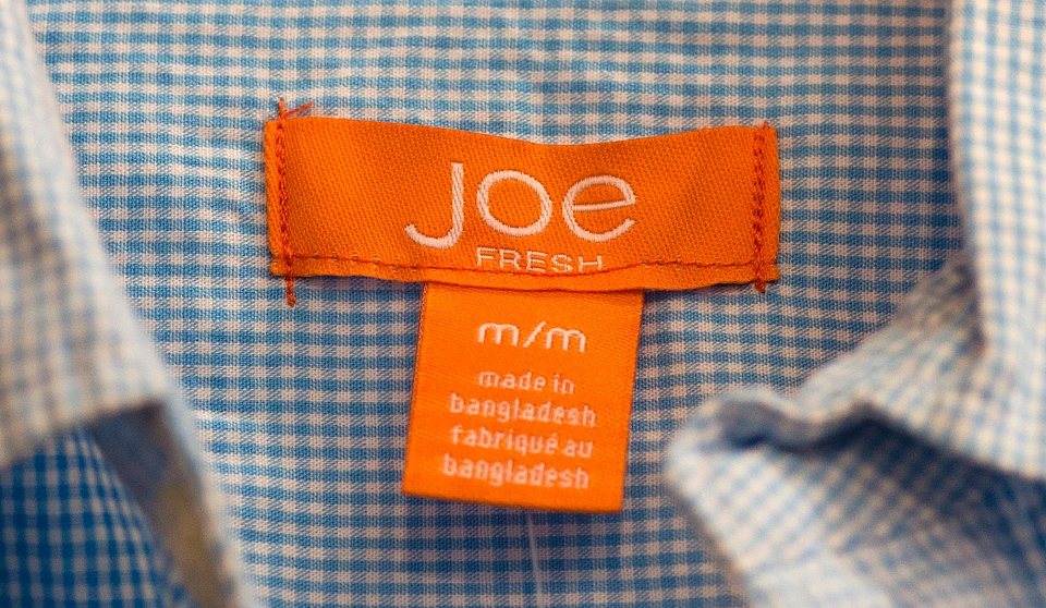 A Joe Fresh garment made in Bangladesh is shown at a Loblaws outlet in Montreal, Thursday, April 25, 2013. (THE CANADIAN PRESS/Graham Hughes)