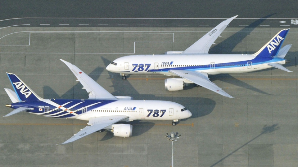 Nippon Airways Boeing 787 planes sit on a tarmac at Haneda Airport in Tokyo, Friday, April 26, 2013. (Kyodo News)