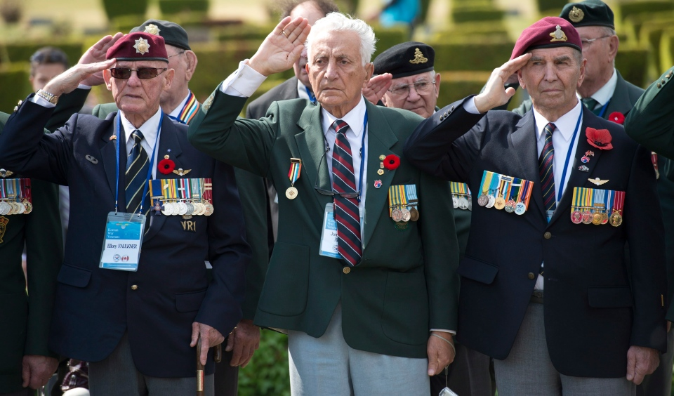 Canadian Korean War veteran's Ellroy Faulkner (left), Joseph Ritchie and Aime Michaud salute as they take part in a Canadian ceremony at the United Nations Memorial Cemetery in Korea Friday April 26, 2013 in Busan, Republic of Korea. (Adrian Wyld / THE CANADIAN PRESS)