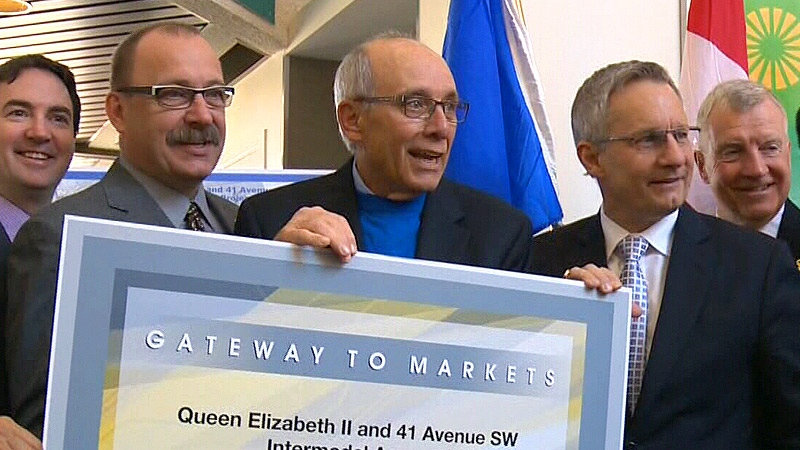 Provincial Transportation Minister Ric McIver (L), Edmonton Mayor Stephen Mandel (C), and Federal Minister of International Trade Ed Fast (R) pose after signing a ceremonial agreement ahead of construction on the QEII and 41 Ave. Intermodal Access project.
