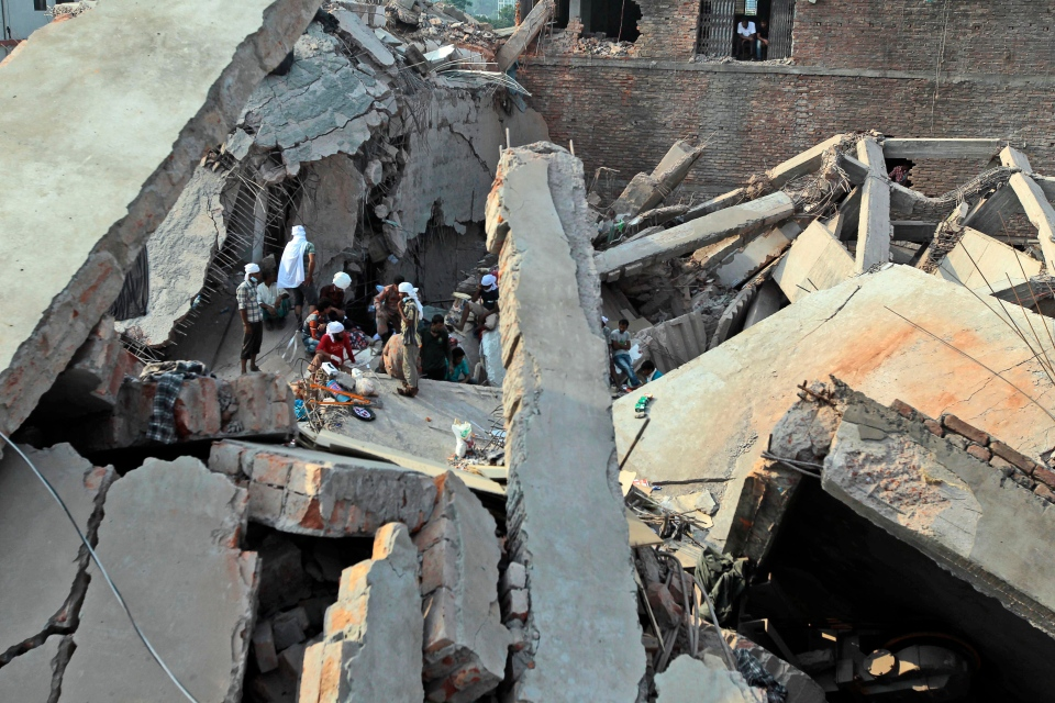 Bangladeshi rescuers work at the site of a building that collapsed Wednesday in Savar, near Dhaka, Bangladesh, Friday, April 26, 2013. (AP / A.M. Ahad)