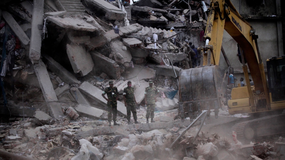 Bangladeshi soldiers stand in the rubble at the site where a building collapsed Wednesday in Savar, near Dhaka, Banglades, Friday, April 26, 2013. (AP / Kevin Frayer)