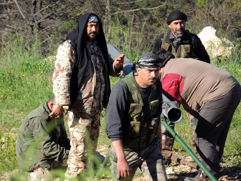 Members of the Free Syrian Army fire rockets at President Bashar Assad's hometown of Qardaha, in Jabal al-Akrad region near the coastal city of Latakia, Syria, Friday, April. 26, 2013. (Edlib News Network ENN)