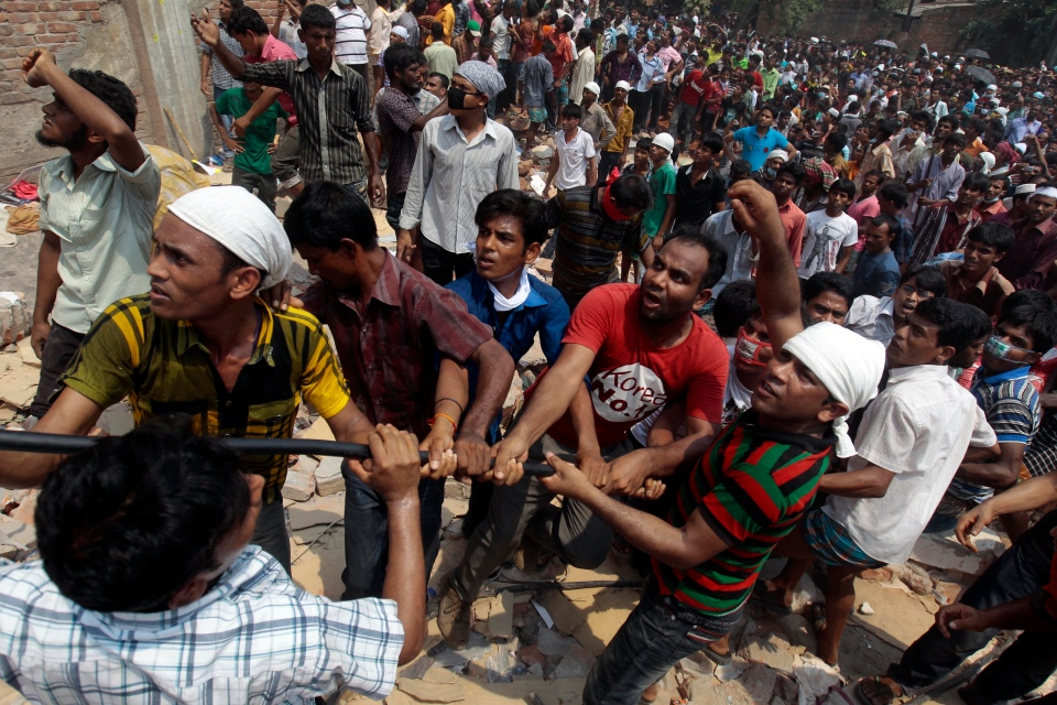 Bangladeshi rescuers work to pull down rubble at the site of a building that collapsed Wednesday in Savar, near Dhaka, Bangladesh, Friday, April 26, 2013. (AP / A.M. Ahad)