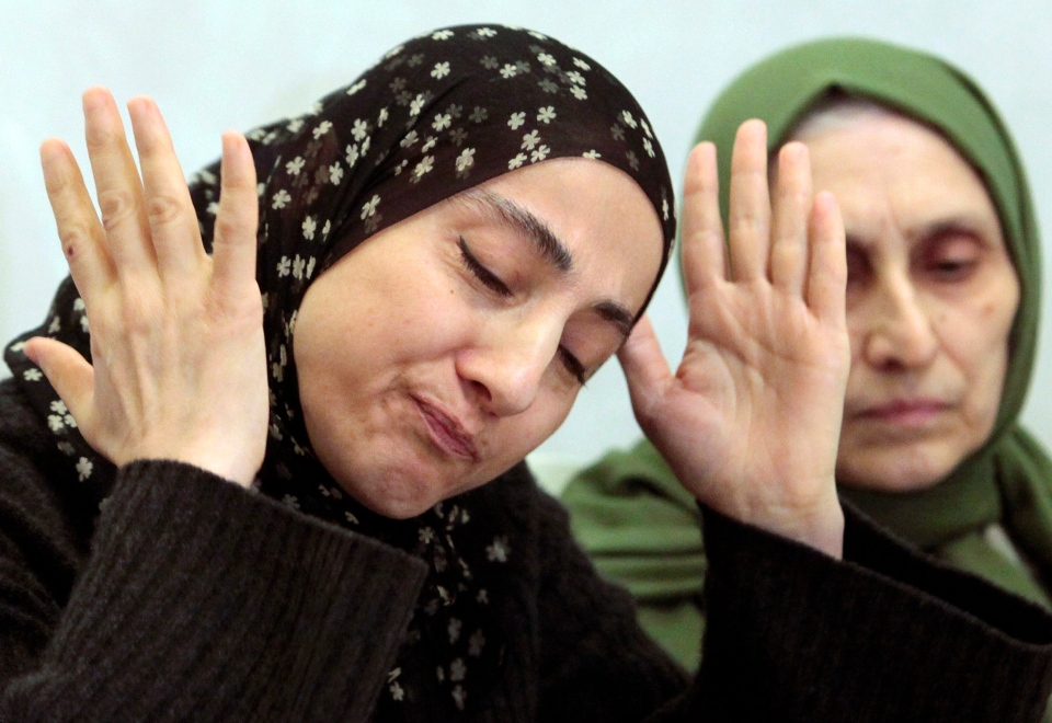 The mother of the two Boston bombing suspects, Zubeidat Tsarnaeva, left, speaks at a news conference in Makhachkala, the southern Russian province of Dagestan, April 25, 2013. (AP / Musa Sadulayev)