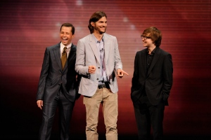 "The cast of 'Two and a Half Men,' from left, Jon Cryer, Ashton Kutcher, and Angus T. Jones are shown during their presentation at CBS' Upfront, at Carnegie Hall, in New York in this May 18, 2011 publicity image released by CBS. CBS said Friday, April 26, 2013, it's renewed ""Two and a Half Men"" for another season. (CBS / Jeffrey R. Staab)"