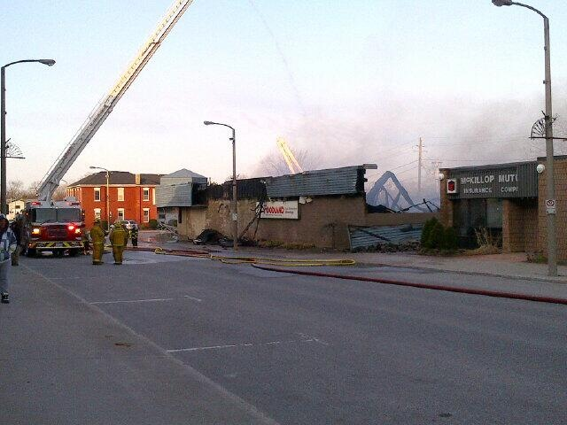 Fire crews pour water on the Seaforth Foodland fire on Saturday, April 27, 2013. (Courtesy Gerrid Dalton)