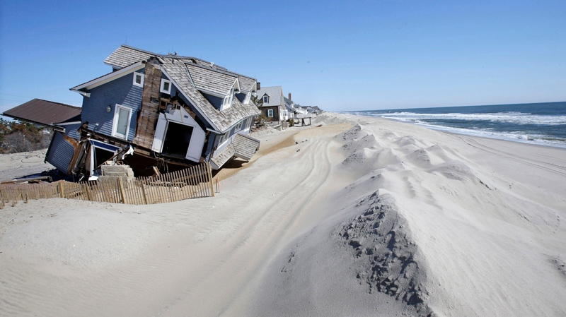 Homes severely damaged last October by Superstorm Sandy, are seen along the beach in Mantoloking, N.J., Thursday, April 25, 2013. (AP / Mel Evans)