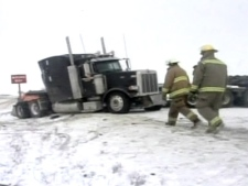 Firefighters arrive at the scene of an accident involving a tractor-trailer in Edmonton on Monday, April 21, 2008.