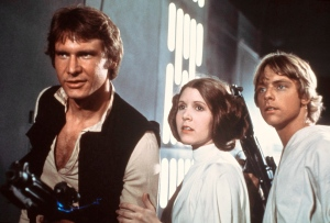 Harrison Ford as Han Solo, Carrie Fisher as Princess Leia Organa and Mark Hamill as Luke Skywalker in a scene from the 'Star Wars' movie released by 20th Century-Fox in 1977.