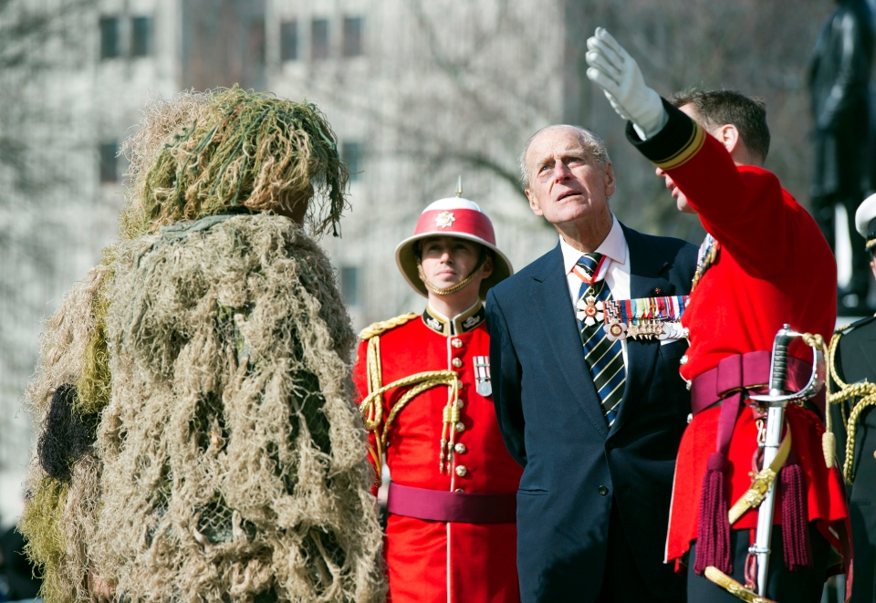 HRH Prince Philip chats with members of the 3rd Battalion of The Royal Canadian Regiment at the Ontario Legislature in Toronto on Saturday April 27, 2012. (Frank Gunn / THE CANADIAN PRESS)