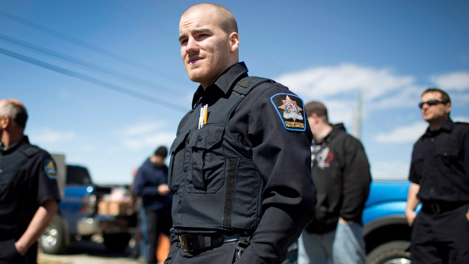 Hundreds of Alberta jail guards taking part in a widespread wildcat strike are returning to work on Wednesday, May 1, 2013 after their union struck a deal with the province.  (Jason Franson / THE CANADIAN PRESS)