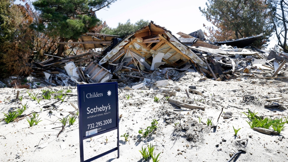 A realty sign stands on a lot where the home was destroyed last October by Superstorm Sandy in Mantoloking, N.J., Thursday, April 25, 2013. (AP / Mel Evans)