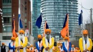 A parade celebrating the birth of Sikhism makes its way down Lake Shore Boulevard in Toronto on Sunday, April 24, 2011. (The Canadian Press/Aaron Vincent Elkaim)