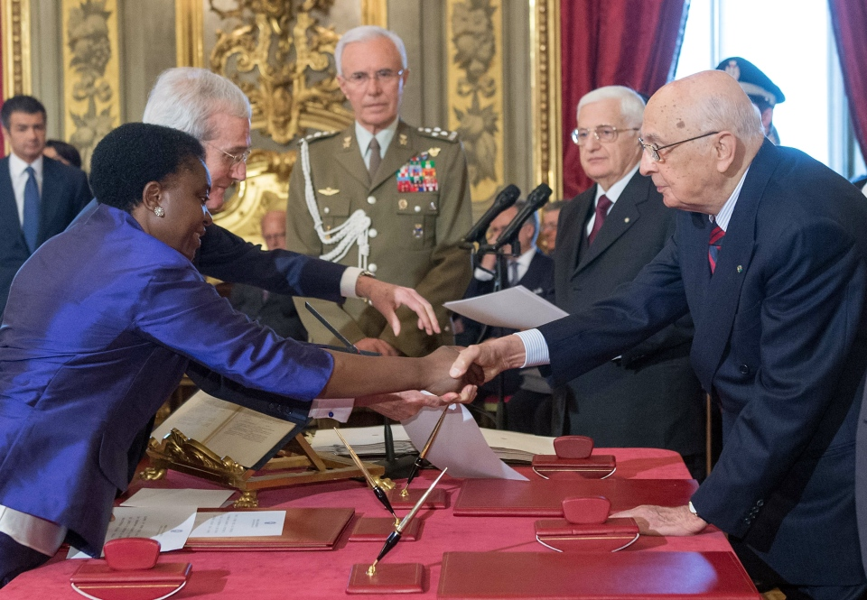 Integration Minister Cecile Kyenge, of Congolese origin, left, shakes hands with Italian President Giorgio Napolitano after taking oath during the swearing in ceremony of the new government at the Quirinale Presidential Palace, in Rome, Sunday, April 28, 2013. (Paolo Giandotti / Italian Presidential Press service)