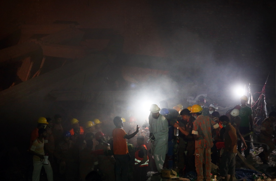 Rescue workers help to put out a fire which broke out in a garment factory building which collapsed Wednesday in Savar, near Dhaka, Bangladesh, Sunday April 28, 2013. (AP / Wong Maye-E)