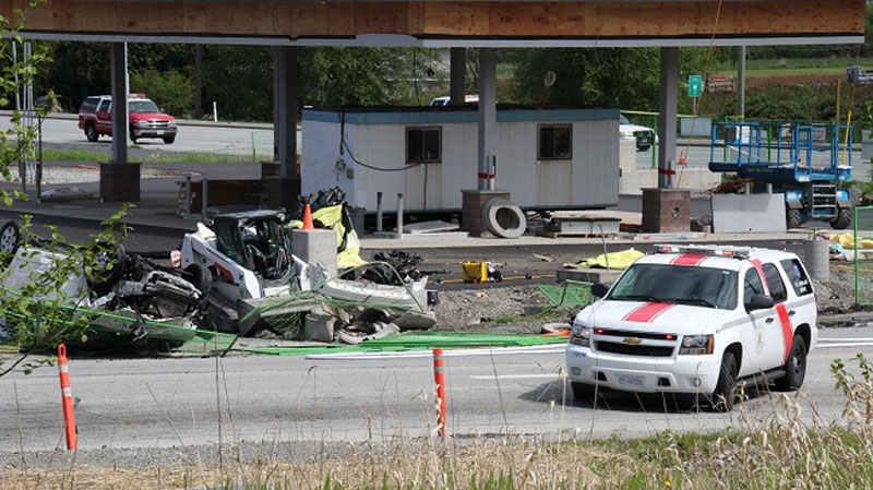 The RCMP respond to a fatal vehicle crash in Surrey, B.C., Sunday, April 28, 2013.