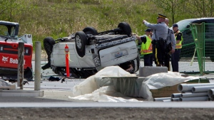 Police investigate the aftermath of a fatal car crash at the intersection of 176th Street and 32nd Avenue in Surrey, B.C. on Sunday, April 28, 2013. (Eric Dreger / THE CANADIAN PRESS)