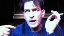 This image taken from video shows Charlie Sheen during an Internet broadcast following his firing from 'Two and a Half Men,' late Monday, March 11, 2011.