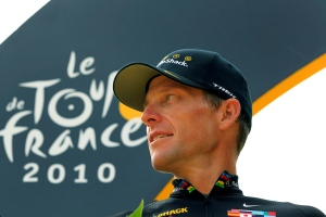 In this July 25, 2010, file photo, Lance Armstrong looks back on the podium after the 20th and last stage of the Tour de France cycling race in Paris, France. (AP Photo/Bas Czerwinski, File)