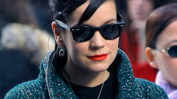 British singer Lily Allen poses for photographers prior to Chanel's Fall-Winter ready-to-wear 2012 collection, in Paris, Tuesday, March 8, 2011. (AP / Jacques Brinon)