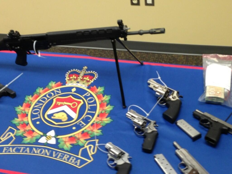 Guns seized by police on Friday are seen on display in London, Ont. on Monday, April 29, 2013. (Gerry Dewan / CTV London)