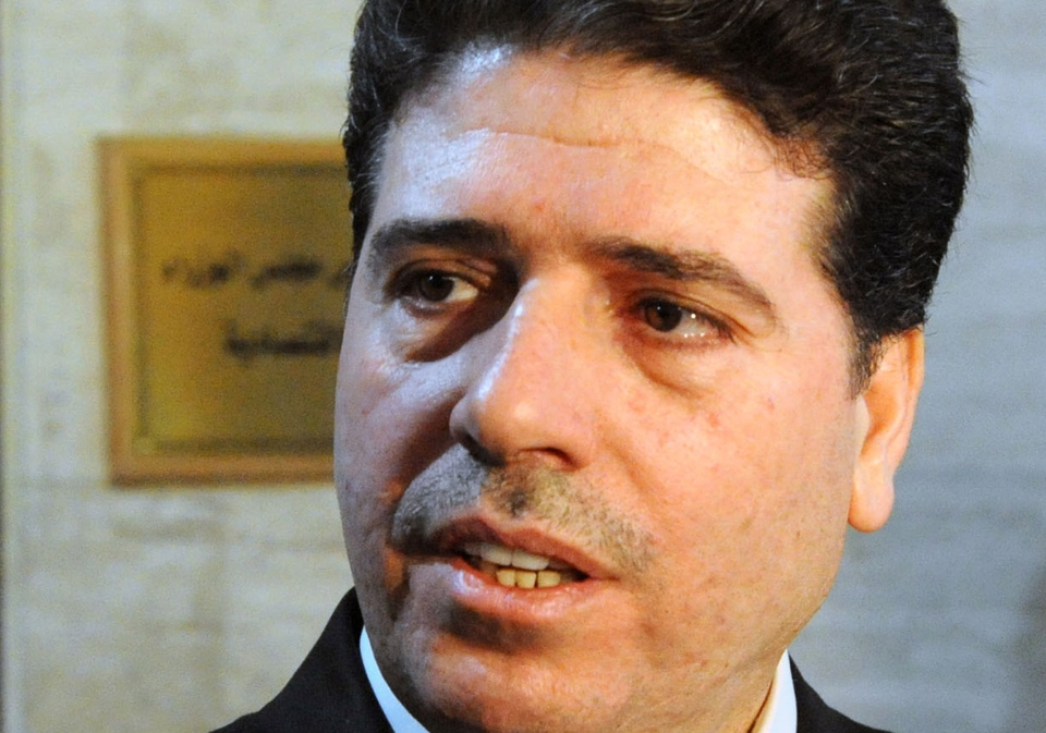 Syrian Prime Minister Wael al-Halqi, who his convoy attacked by bomb, speaks to journalists after an economic meeting, in Damascus, Syria, April 29, 2013. (SANA)
