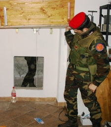 An Italian Carabinieri paramilitary police officer shows the entrance of a bunker where Francesco Maisano, an alleged boss, tried to hide when police raided his home. Maisano was arrested in Reggio Calabria, southern Italy, Tuesday, March 8, 2011. (AP / Italian Carabinieri HO)