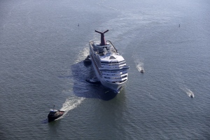 The disabled Carnival Lines cruise ship Triumph is towed to harbor off Mobile Bay, Ala., Feb. 14, 2013. (AP / Gerald Herbert)