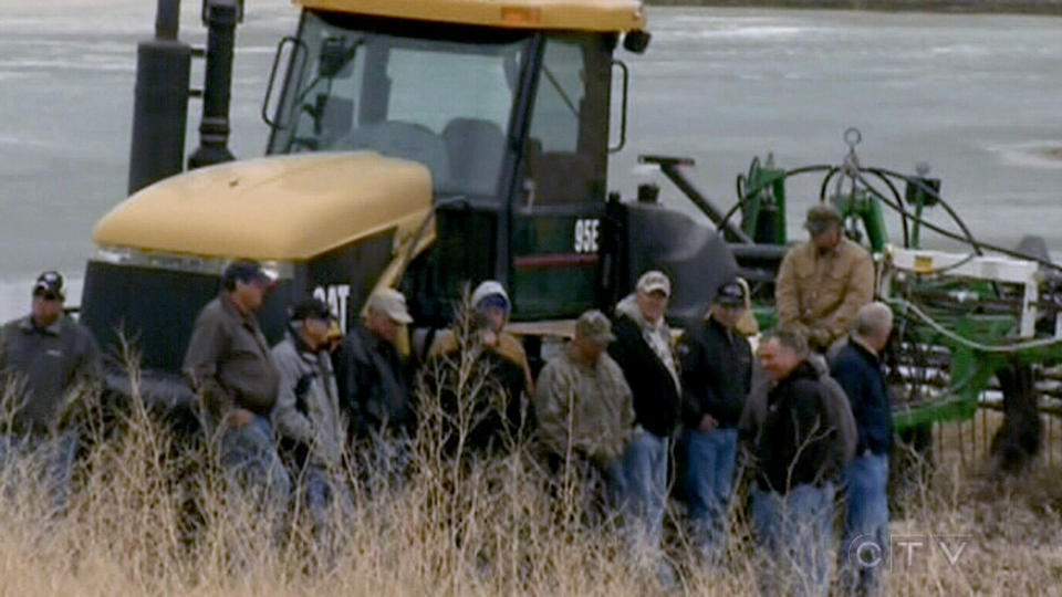Farmers protest against plans to flood their land near Portage la Prairie, Manitoba, Monday, April 29, 2013.