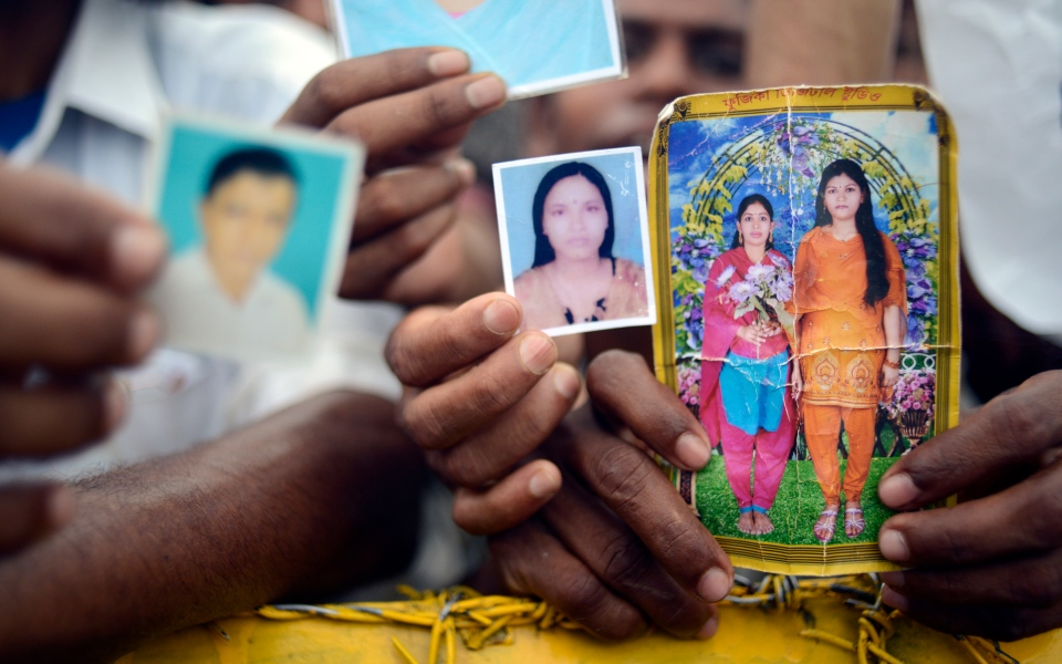 Family members hold portraits of their missing friends and family in Savar, near Dhaka, Bangladesh, on  on Monday 29 April, 2013. (AP / Ismail Ferdous)